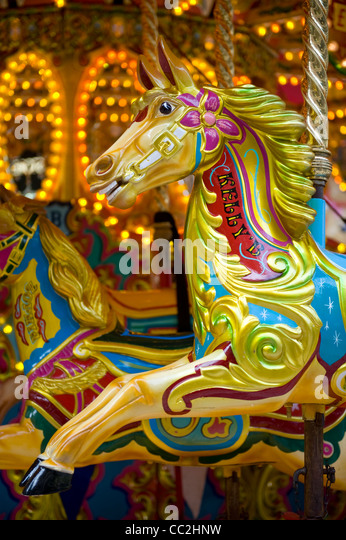 Horse rides on a traditional victorian carousel - Stock-Bilder