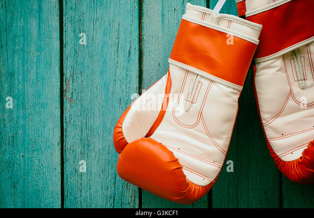 Vintage wooden background with a pair of boxing gloves,  toning - Stock-Bilder