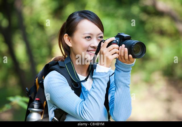 Photographer on Hike - Stock Image