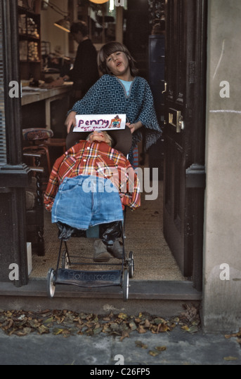 Girl collecting for  'Penny for the guy' - Stock Image