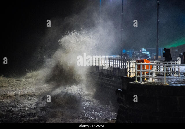 Aberystwyth Wales UK Monday  09 November 2015   The second high tide of the day, after sunset, brings more strong - Stock Image