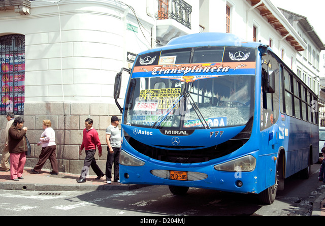 Its windscreen listing destinationsl, a bus enters the San Francisco plaza on its route through Quito, Ecuador's - Stock Image