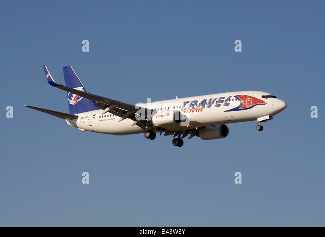 Travel Service Boeing 737-800 on arrival - Stock-Bilder