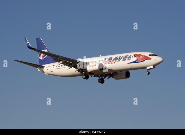 Travel Service Boeing 737-800 on arrival - Stock-Bilder