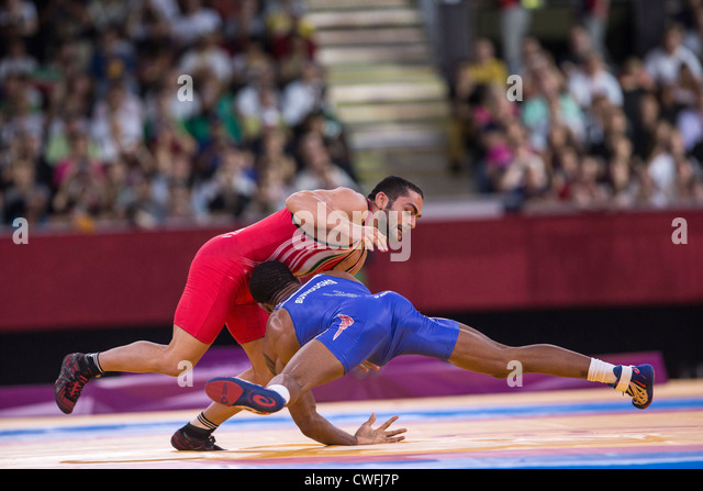 Jordan Ernest Burroughs (USA) -B- vs Sadegh Saeed Goudarzi (IRI) in Men's 74kg Freestyle Wrestling at the Olympic - Stock Image