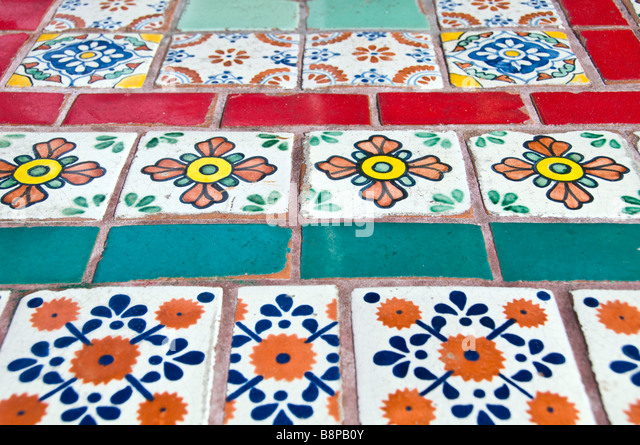 Colorful mexican ceramic tiles brightly colored painted designs San Antonio Texas - Stock Image