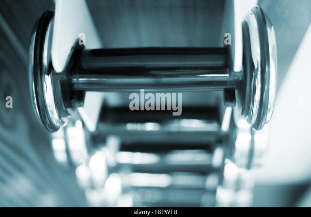 Dumbbells gym metal weights in exercise room in gym health club fitness studio for bodybuilding and weight training - Stock-Bilder