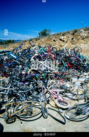Discarded bicycles piled for recycling. - Stock Image