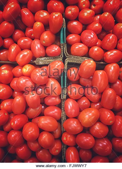 High Angle View Of Tomatoes For Sale At Market Stall - Stock Image