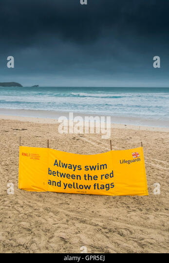 A RNLI safety banner on Fistral; Beach in Newquay, Cornwall. - Stock Image