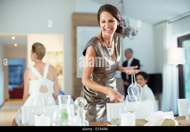 Woman setting table for party - Stock Image