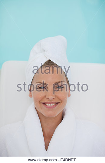 Woman laying poolside - Stock Image
