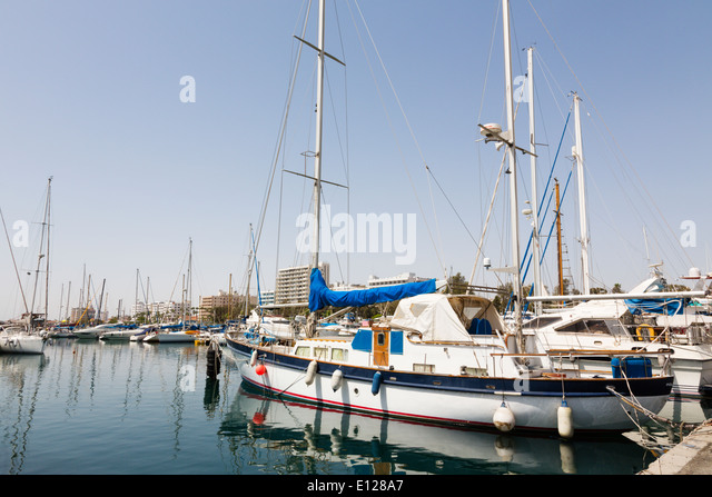 Larnaca Marina with seafront hotels in the background. - Stock Image