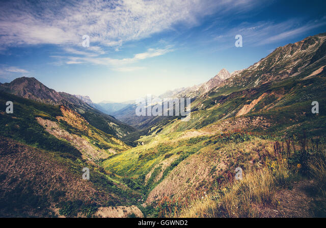 Mountains idyllic Landscape in Abkhazia with blue sky and clouds Summer Travel serene scenic aerial view - Stock Image