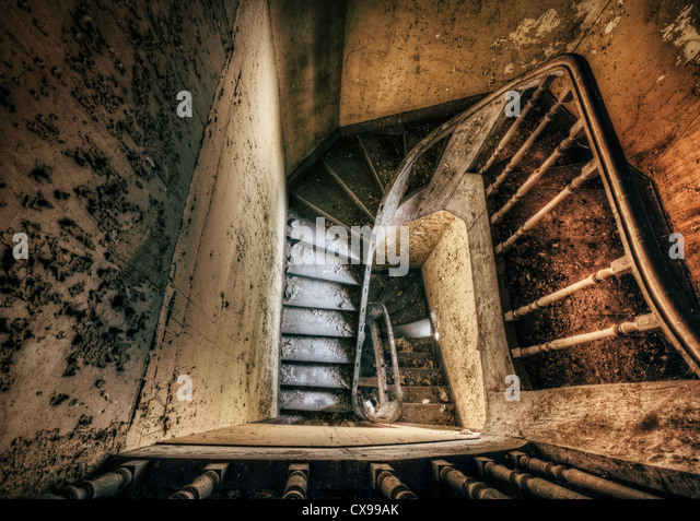 Staircase of spooky abandoned house - Stock Image