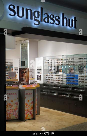 Boston Massachusetts Logan International Airport BOS gate area concourse shopping for sale display Sunglass Hut - Stock Image