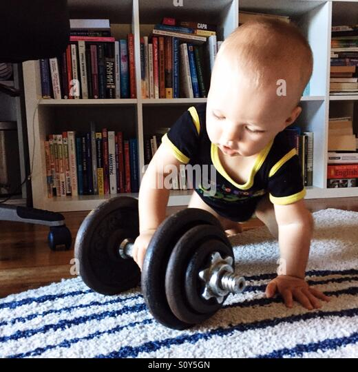 Child playing with gym equipment - Stock Image
