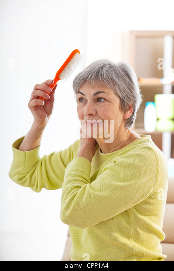 HAIR CARE, ELDERLY PERSON - Stock Image