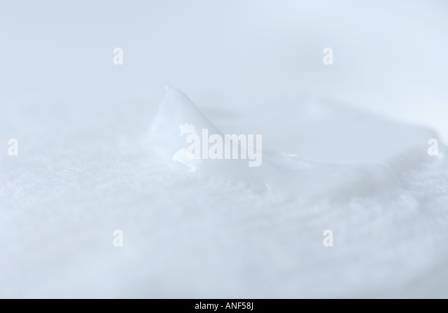 Lotion on cotton pad, extreme close-up - Stock Image