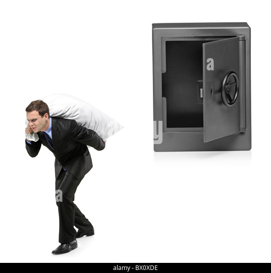 Full length portrait of a man stealing a money bag from a deposit safe - Stock Image