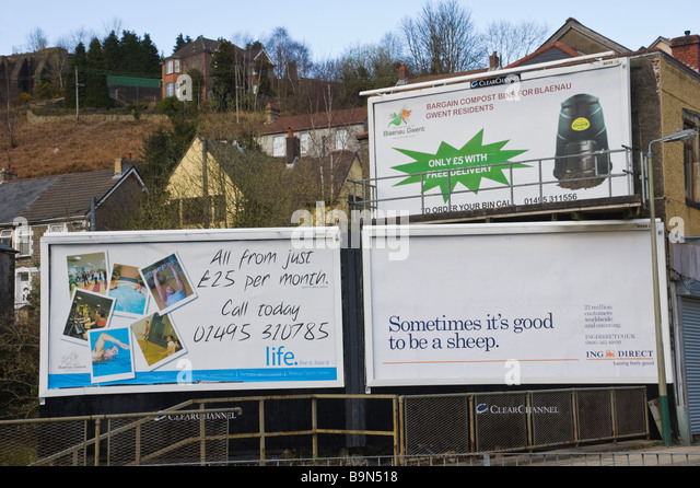 Multiple ClearChannel advertising billboards local council and ING Direct at Crumlin in South Wales Valleys UK - Stock Image