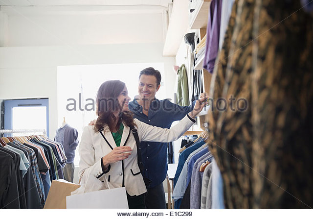 Couple browsing in clothing shop - Stock Image