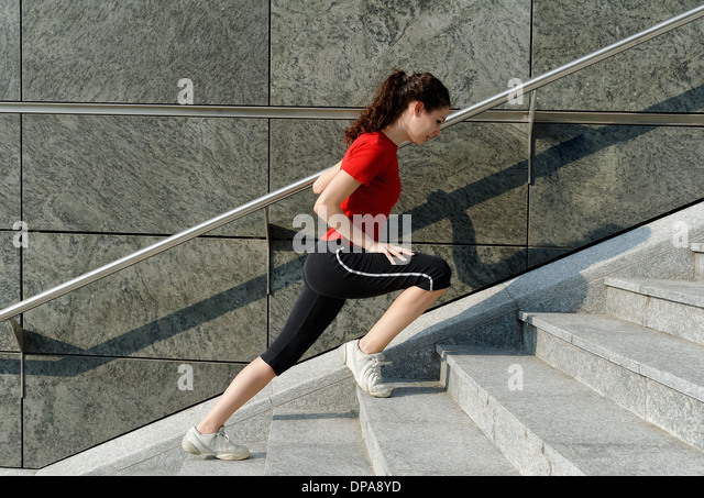 Young woman training on stairway - Stock-Bilder