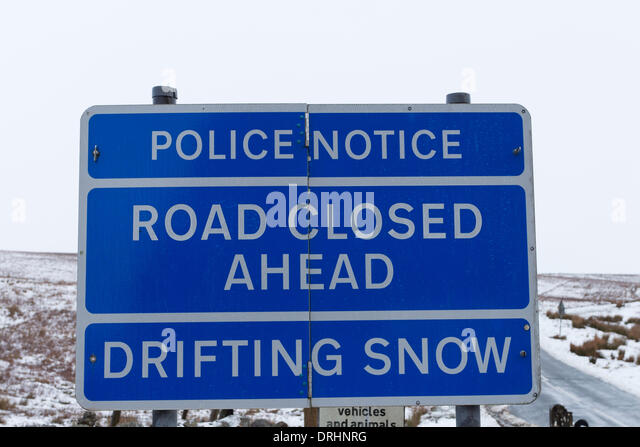 County Durham, UK. 27th January 2014. Road closed due to drifting snow and icy conditions at the junction of the - Stock Image