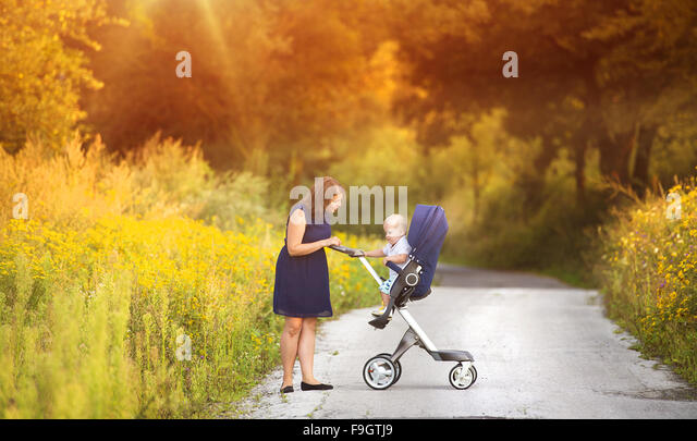 Mother and son on a walk in nature enjoying life together. - Stock Image