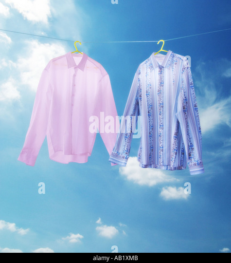 two shirts holding hands - Stock-Bilder