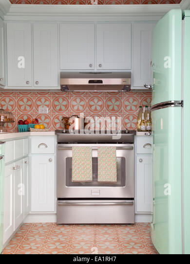 small guest cottage kitchen with retro style refrigerator. - Stock Image