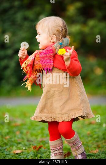 Little girl walking in the park - Stock Image