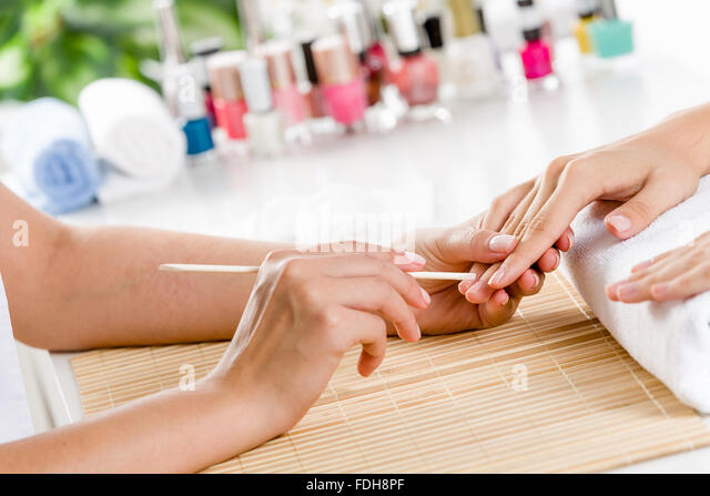 Close up of process of manicure at beauty salon - Stock Image