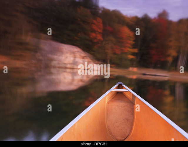 Canoeing on lake George in fall. Killarney Provincial Park, Ontario, Canada. - Stock Image