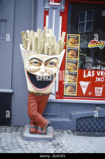 Antwerp Belgium 3 D advertising sign outside fast food burger restaurant for frites, figure with carnival head - Stock Image