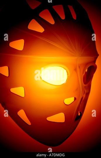 eerie Halloween view of ice hockey mask worn by goalies - Stock Image