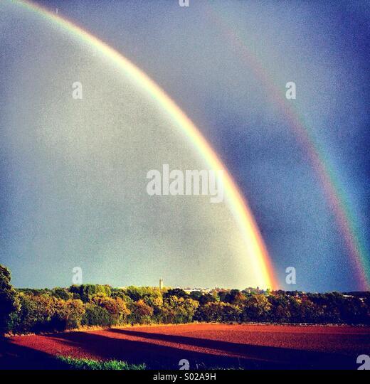 Double rainbow over Warwick, Warwickshire seen from Hampton Magna - Stock Image