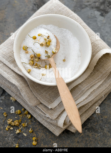 Natural bath salts with dried camomile flowers - high end Hasselblad 61mb digital image - Stock Image