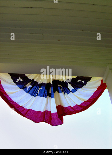 Red White and Blue Stars and Stripes Banner on Porch with Copy Space - Stock Image