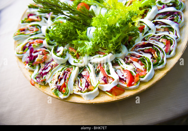 Mozzarella slices stuffed with vegetables - Stock Image