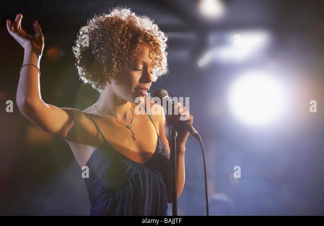 Jazz singer on stage, portrait - Stock Image