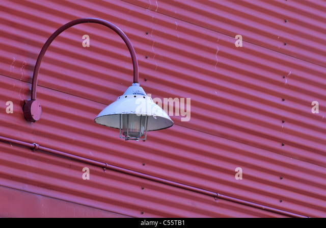 Lamp mounted with corrugated iron, Granville Island, Vancouver, British Columbia, Canada - Stock Image