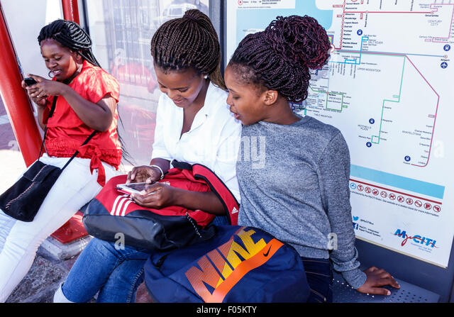Cape Town South Africa African City Centre center Buitenkant Street MyCiTi Bus stop Black girl woman teen student - Stock Image