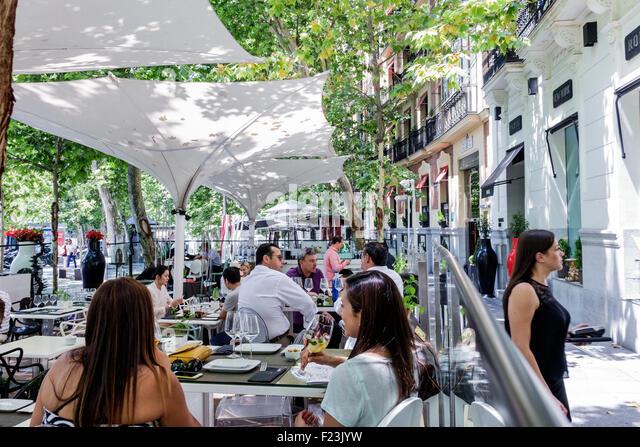 Madrid Spain Europe Spanish Plaza de la Independencia sidewalk cafe restaurant alfresco dining Hispanic woman - Stock Image