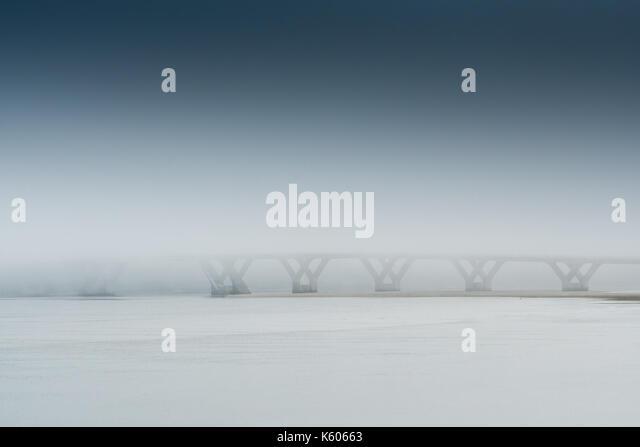 Rainy Mist Engulfs the Alsea Bay Bridge along the Oregon coast - Stock Image