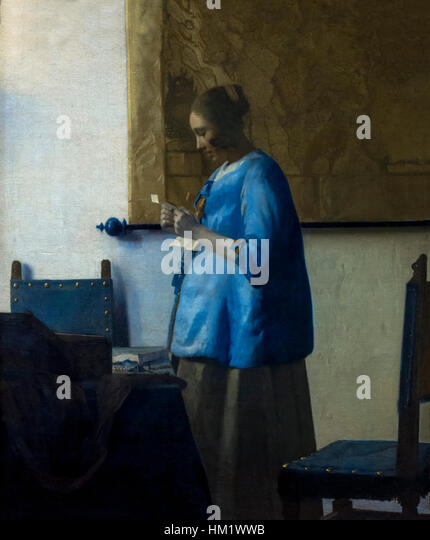 Woman Reading a Letter, by Johannes Vermeer, circa 1663, Rijksmuseum, Amsterdam, Netherlands, Europe, - Stock Image