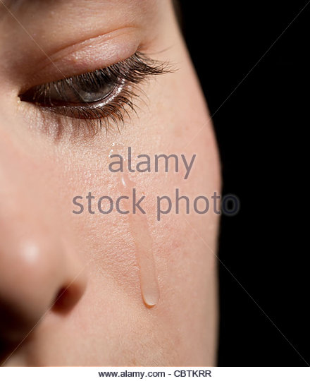 close-up of a young woman crying - Stock Image
