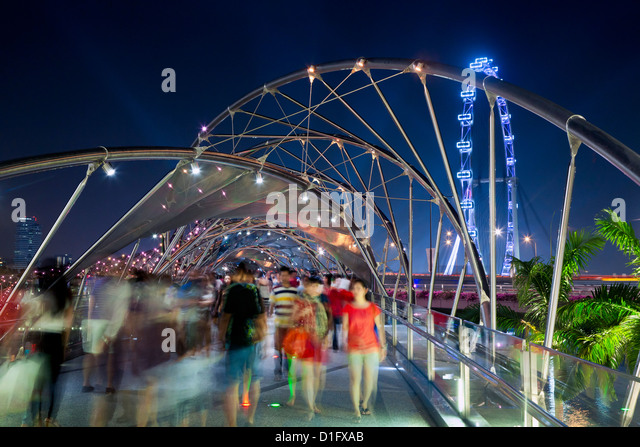 The Helix bridge at Marina Bay and Singapore Flyer, Singapore, Southeast Asia, Asia - Stock Image