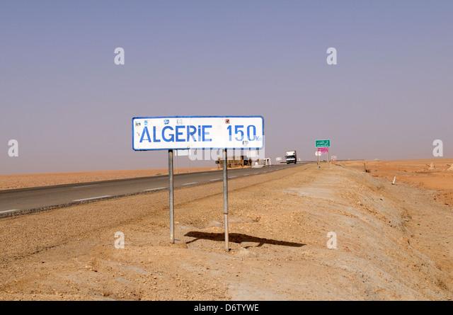 Road sign 150 kilometers from Tunisia to Algeria through Chott El Jerid salt flats - Stock Image