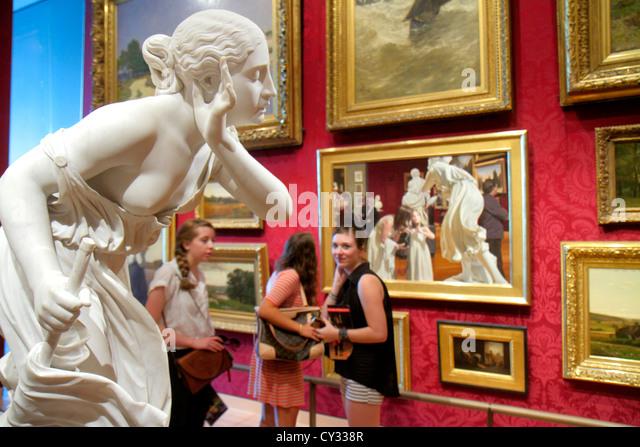 Boston Massachusetts Huntington Avenue Museum of Fine Arts collection paintings art woman viewing sculpture - Stock Image